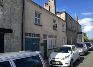 LOCATION: PEMBROKE. Presenting a lovely character 3 bedroomed unfurnished terraced cottage benefitting from gas fired central heating. Accommodation briefly comprises entrance hall, lounge with wood burner and TV point, snug room, dining room with sp...