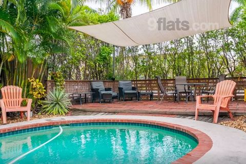 This home is a duplex - meaning there is a second home adjacently attached through a concrete wall. Less than 5 minutes walk to the beach! Private Heated Pool! Live in a house, just like at home! Full kitchen, free parking, flat screen TV, high speed...