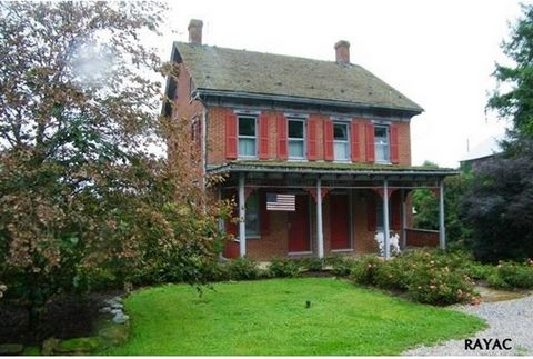 Active: Traditional German Brick Farmhouse with 2 front doors built in 1909. History abounds from this site. Spring House is where family that built the home stayed during the home's construction. Land is currently leased for Orchard's. SOLD AS IS! I...
