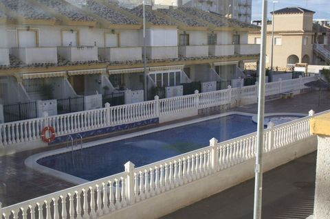 2 BEDROOM TOWNHOUSE IN PLAYA PARAISO, MURCIA. Approximately 200 mts from one of the Mar Menor's beautiful beaches in a quiet urbanization, 5 minutes from Cabo de Palos and the La Manga strip. Within a 10 minute drive of the world famous La Manga Club...