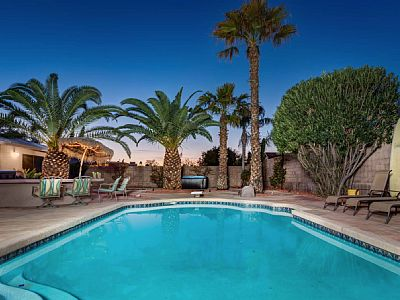This backyard will make you feel like you are at the beach! Beautifully remodeled 4 bedroom and 2 bathroom home! The bedrooms are professionally furnished and decorated for ultimate comfort.