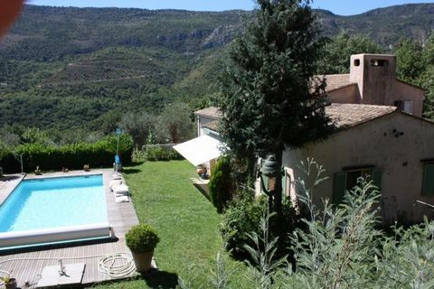Sandrine ZWEIFEL offers you In Contes, 20 minutes from Nice, traditional 5-room villa of 120 m2 comprising a living room with fireplace, opening onto a covered south facing terrace and a 10x5 swimming pool, a mezzanine office, 3 bedrooms each with an...