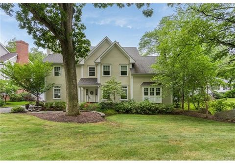 Young 5 Bedroom/3.1 Bath Colonial/split level with beautiful finishes and great flow for everyday living and great parties! The large custom Kitchen, with a 9' long granite-topped center island , a handy built-in desk, and spacious casual dining area...