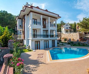 Picturesque brand new 5 bedroom villa with private pool in Ovacik with a beautiful panoramic forest and mountain view. Nice well groomed garden. Rates: nightly-weekend - from 158.15 to 158.15 USD