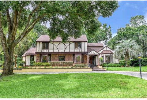 Elegantly appointed SE Ocala home in gated/guarded community. 4 bedroom, 3.5 bath Tudor style home in Laurel Run. Volume wood ceiling with stain glass accent window over looking a vast family room with wet bar and brick gas fireplace. Master suite on...