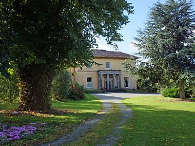 Outside: Self contained wing of fine country house (dating just before 1800) on delightful estate beside the River Clashawley. It is situated near the small historic town of Fethard (c.2km / 1.3 miles) located in Ireland's 'Ancient East'.