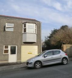 2 bed semi detached house with garage located in a popular residential street close to the town centre of Pembroke Dock. This property has gas central heating and double glazing and the accommodation is light and comfortable and consists of: entrance...