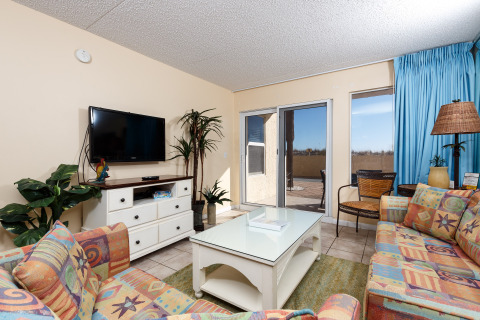 This beautiful ground floor condo includes patio doors in the living room leading to a private patio that provides a place to relax and unwind. Other features of this tropically decorated vacation rental unit includes a full-size refrigerator, cook-t...