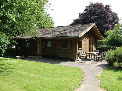 The log cabin is 54m² in size and offers accommodation for 5 people. It has a double bedroom with a double bed with a sleeping / or children's room with bunk bed and single bed and an optional extra cot.