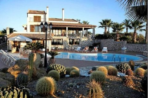 Villa Diva is located inside the Saline Nature Reserve of Trapani and Paceco. A great variety of palms, ferns, dwarf palms, carob trees and typical Mediterranean plants and flowers are present in its lush garden. A well-kept lawn leads to the wide an...