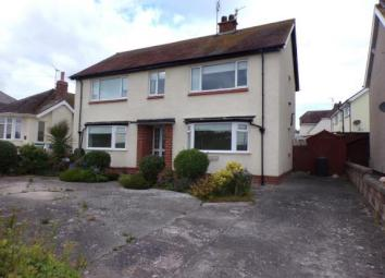 The property comprises; hallway, lounge with feature fireplace and bay window, kitchen with French doors leading into a large conservatory. There are two double bedrooms, one having en-suite facilities, and a modern shower room. The property benefits...