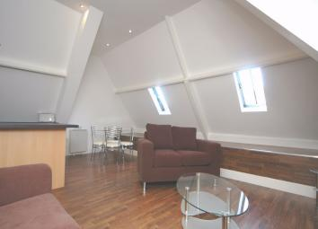 Wonderfully stylish, one bedroom third floor converted loft apartment featuring a magnificent, vaulted open plan living room into fitted kitchen, contemporary furnishings and high quality modern specification throughout. The accommodation briefly com...